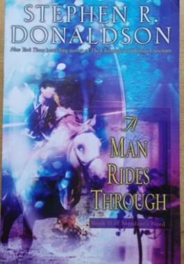 man rides through